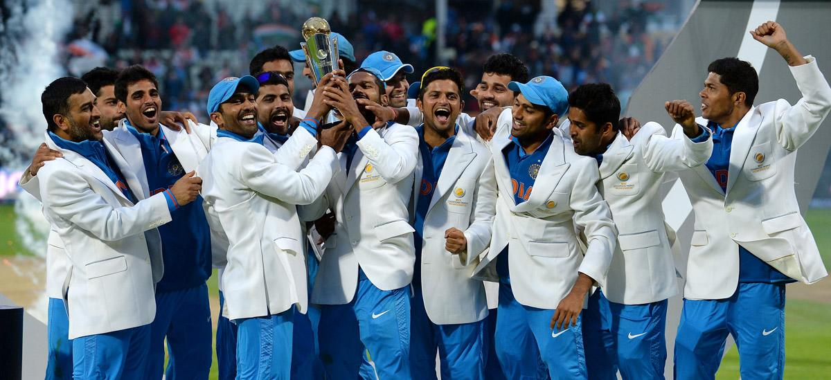 The Indian cricket team celebrates with trophy following victory in the 2013 ICC Champions Trophy Final cricket match between England and India at Edgbaston in Birmingham, central England on 23, June 2013.  India beat England by five runs to win the Champions Trophy final at Edgbaston as the hosts' wait for a major one-day international title continued.   AFP PHOTO/ANDREW YATES