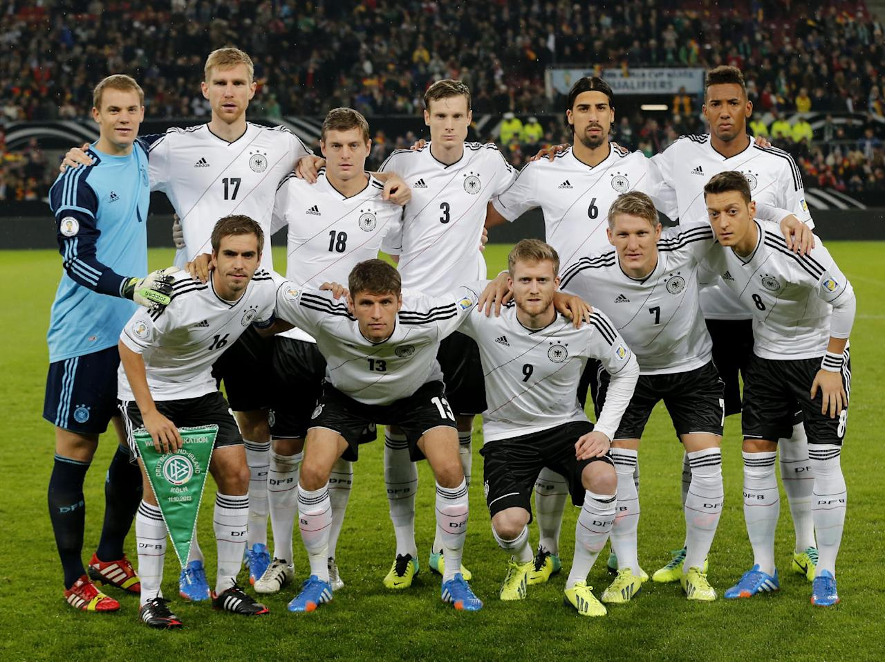 FILE - In this Oct 11, 2013 file photo, Germany soccer team poses prior to the start the World Cup Group C qualifying soccer match between Germany and Ireland in Cologne, Germany. Background from left: Manuel Neuer, Per Mertesacker, Toni Kroos. Marcell Jansen, Sami Khedira and Jerome Boateng. Foreground from left: Philipp Lahm, Thomas Mueller, Andre Schuerrle, Bastian Schweinsteiger and Mesut Ozil.  (AP Photo/Michael Probst, File)
