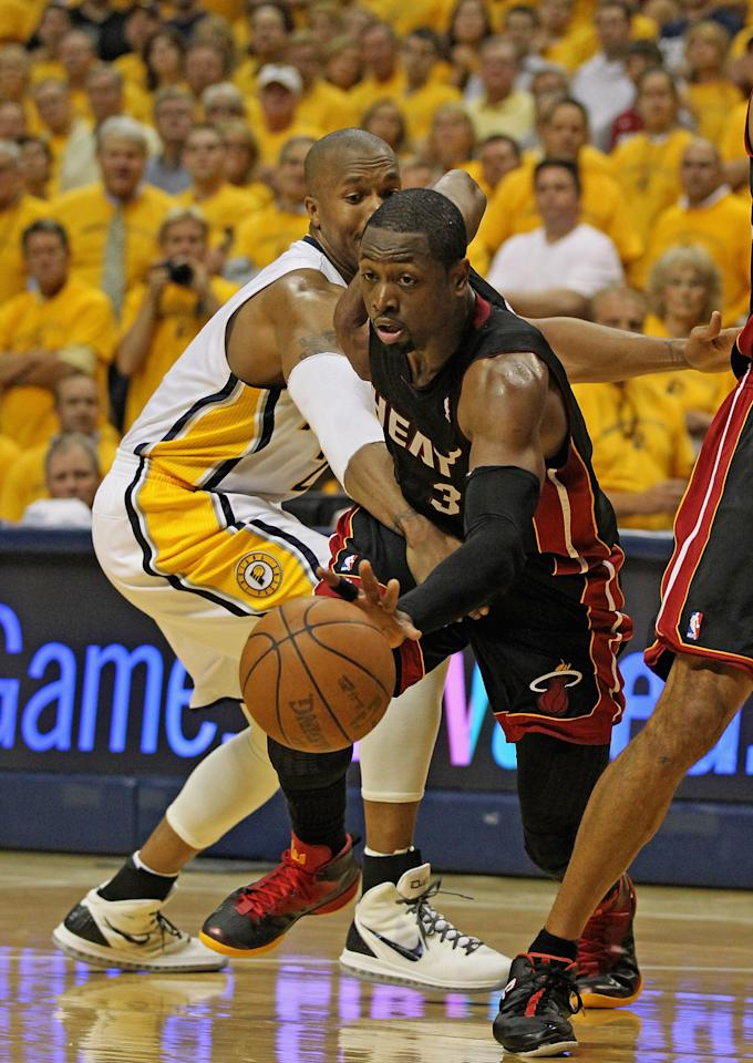 INDIANAPOLIS, IN - MAY 24: Dwyane Wade #3 of the Miami Heat drives past David West #21 of the Indiana Pacers in Game Six of the Eastern Conference Semifinals in the 2012 NBA Playoffs at Bankers Life Fieldhouse on May 24, 2012 in Indianapolis, Indiana. NOTE TO USER: User expressly acknowledges and agrees that, by downloading and/or using this photograph, User is consenting to the terms and conditions of the Getty Images License Agreement. (Photo by Jonathan Daniel/Getty Images)