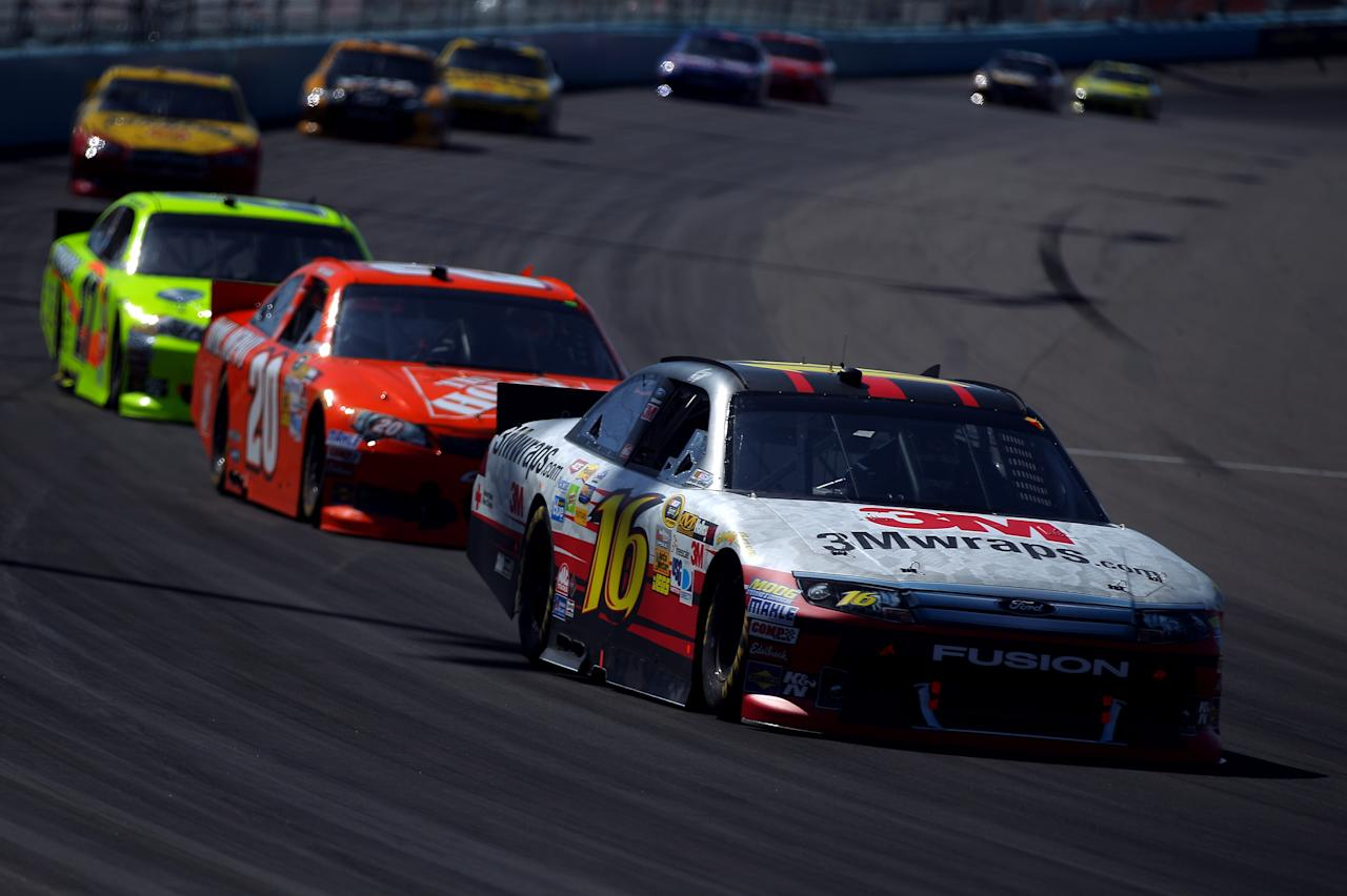 AVONDALE, AZ - MARCH 04:  Greg Biffle, driver of the #16 3MWraps.com Ford, drives ahead of Joey Logano, driver of the #20 The Home Depot Toyota, during the NASCAR Sprint Cup Series SUBWAY Fresh Fit 500 at Phoenix International Raceway on March 4, 2012 in Avondale, Arizona.  (Photo by Justin Edmonds/Getty Images for NASCAR)