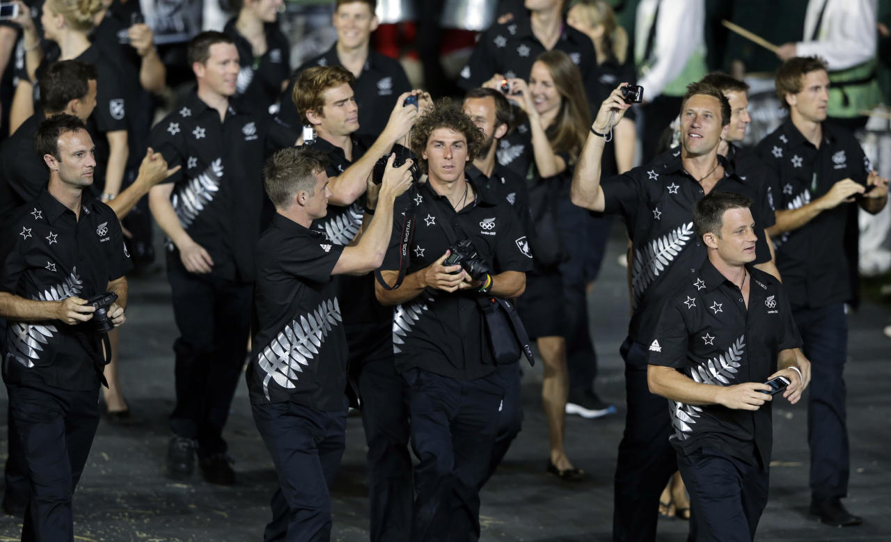 New Zealand athletes walk in a parade during the Opening Ceremony at the 2012 Summer Olympics, Friday, July 27, 2012, in London. (AP Photo/Mark Humphrey)