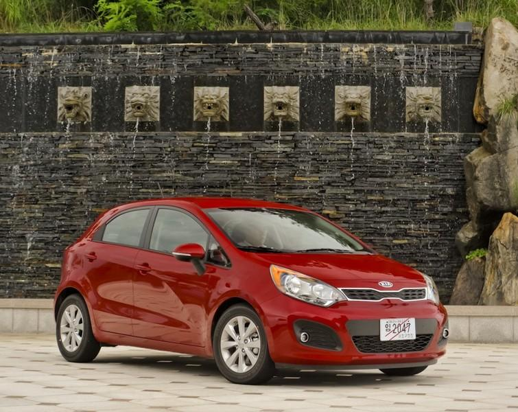 """<b><a href=""""http://autos.yahoo.com/kia/rio-5-door/"""" target=""""_blank"""">Kia Rio5</a></b><br />MSRP: $14,900<br />MPG: 28 City / 36 Hwy<br /><br />The Kia Rio is a peppy, fun ride that makes you feel like a Californian even if you're on the back roads of the Northeast. The tiger snout grill has an attractive pucker, and the new vehicle, unveiled at the 2011 New York Auto Show, has ISG (idle-stop-go) technology, the """"start-stop"""" engine shut-down mechanism to save gas for when the car is idling. It has excellent manueverability and feels just that much easier to slip into a tight parking spot."""