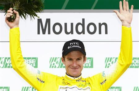 HTC Columbia's team rider Rogers of Australia celebrates on the podium after wearing the leader's jersey during the third and time trial stage of the Tour de Romandie cycling race in Moudon