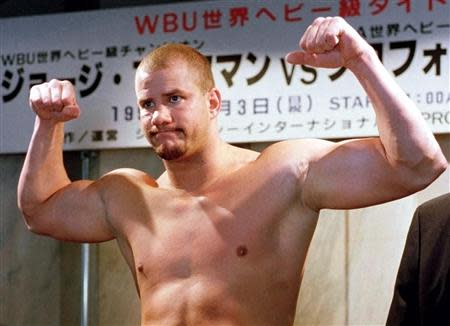 HIV infected heavyweight boxer and former WBO champion Tommy Morrison of the United States poses during a weigh-in in Tokyo in this file photo