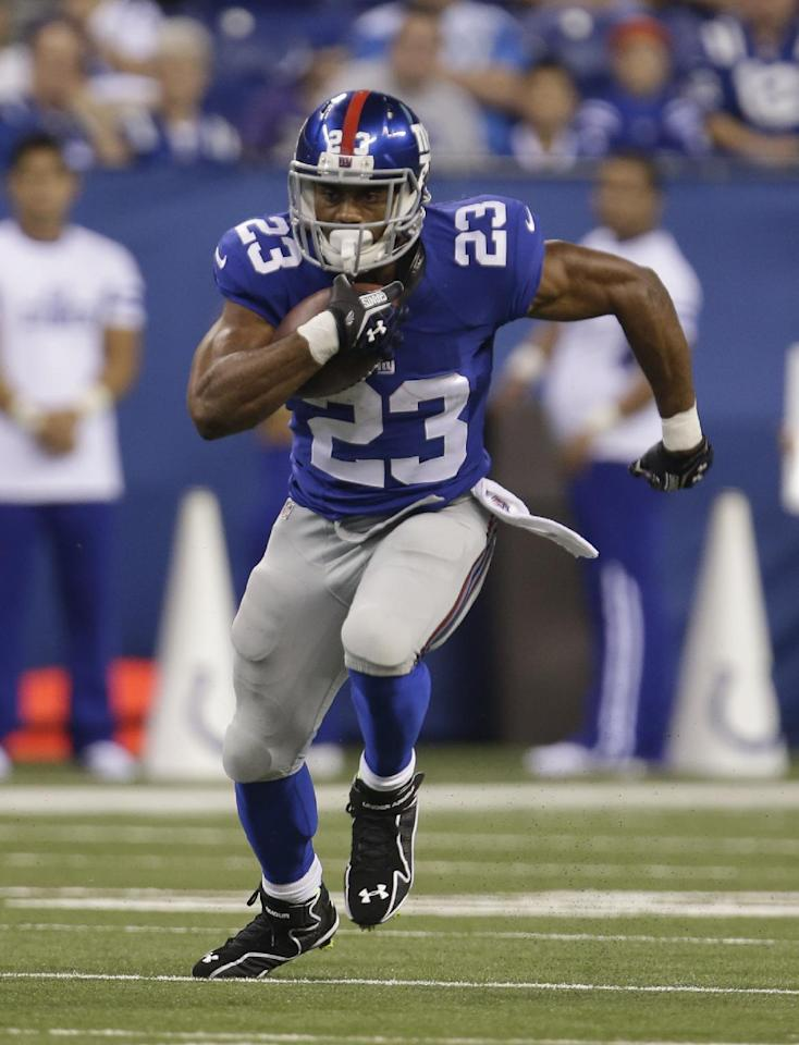New York Giants' Rashad Jennings (23) runs during the first half of an NFL preseason football game against the Indianapolis Colts Saturday, Aug. 16, 2014, in Indianapolis. (AP Photo/AJ Mast)