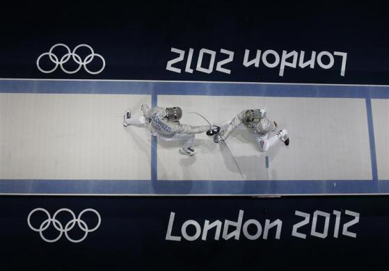Hungary's Aron Szilagyi (R) competes against Italy's Diego Occhiuzzi during their men's sabre individual gold medal fencing match at the ExCel venue at the London 2012 Olympic Games July 29, 2012.