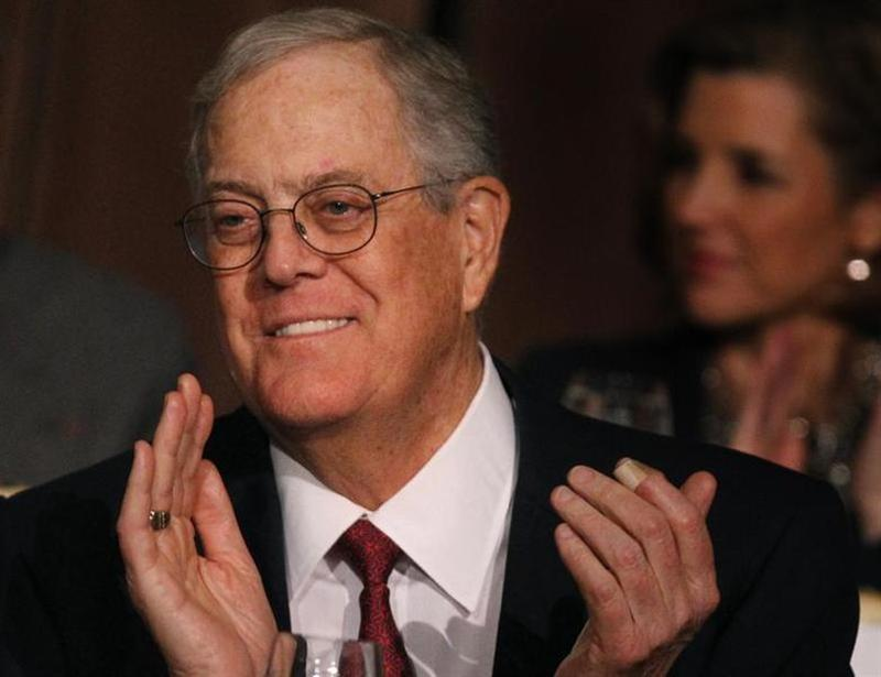 David Koch, executive vice president of Koch Industries, applauds during an Economic Club of New York event in New York