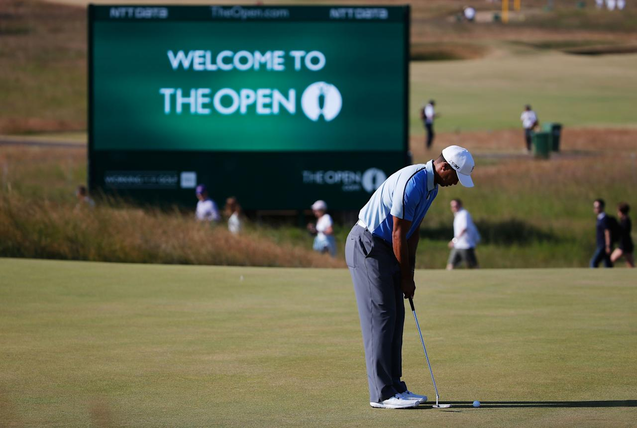 GULLANE, SCOTLAND - JULY 17: Tiger Woods of the United States hits a putt ahead of the 142nd Open Championship at Muirfield on July 17, 2013 in Gullane, Scotland. (Photo by Rob Carr/Getty Images)