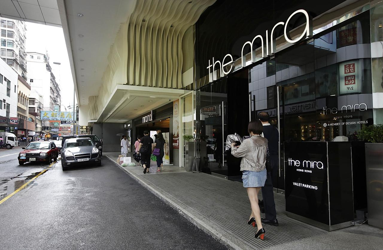 HONG KONG - JUNE 14: A woman walks by the Mira Hotel on June 14, 2013 in Kowloon, Hong Kong. Former CIA employee Edward Snowden, accused of leaking details of top-secret US surveillance of phones and internet, reportedly was staying at the Mira Hotel. (Photo by Jessica Hromas/Getty Images)