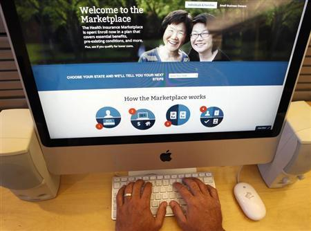 A man looks over the Affordable Care Act signup page on the HealthCare.gov website in New York in this photo illustration