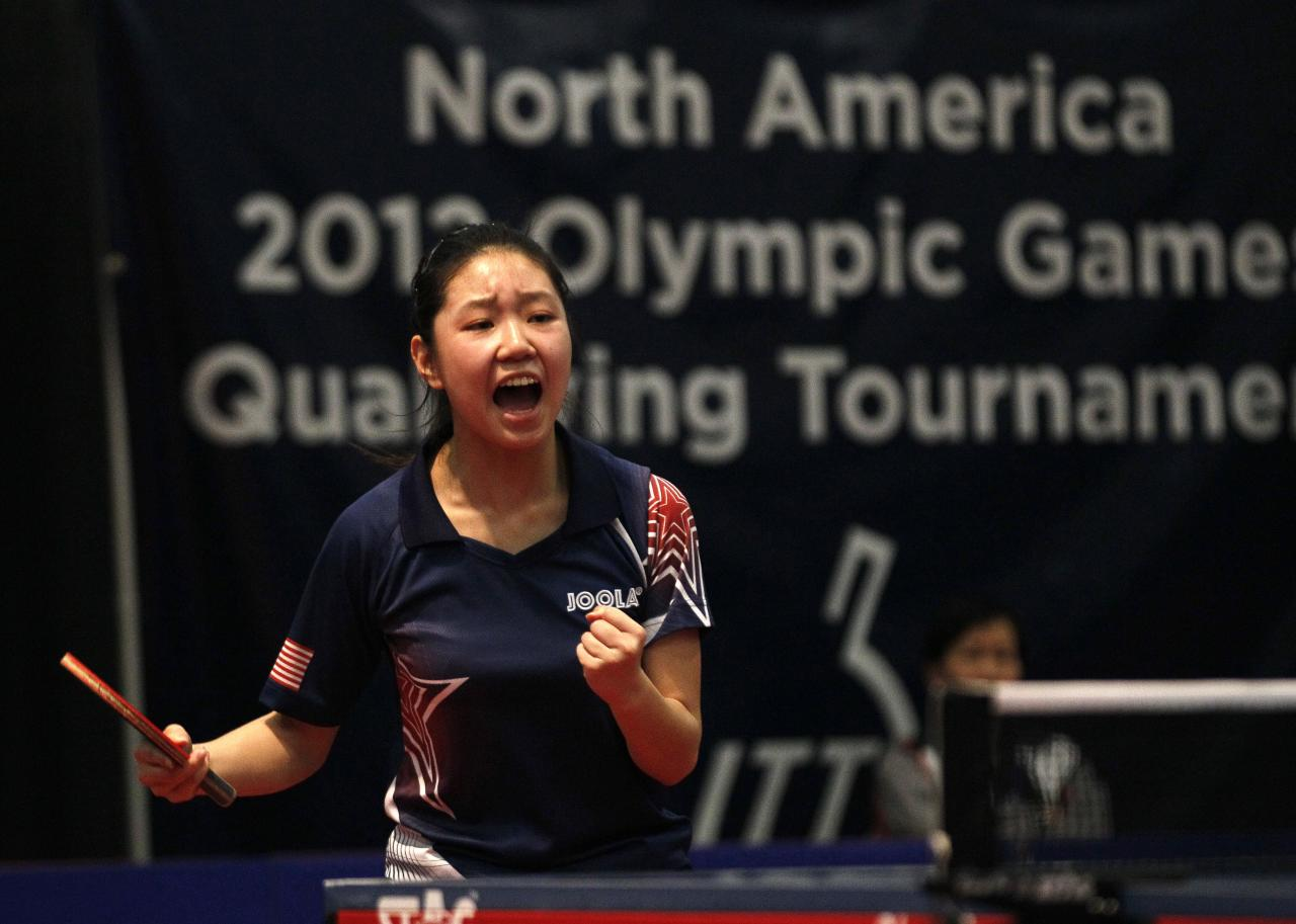United States' Lily Zhang reacts after defeating Canada's Anqi Luo in a women's final of the North America Olympic Games table tennis qualifying tournament in Cary, N.C., Sunday, April 22, 2012. Zhang qualifies for the Olympics with the victory. (AP Photo/Gerry Broome)