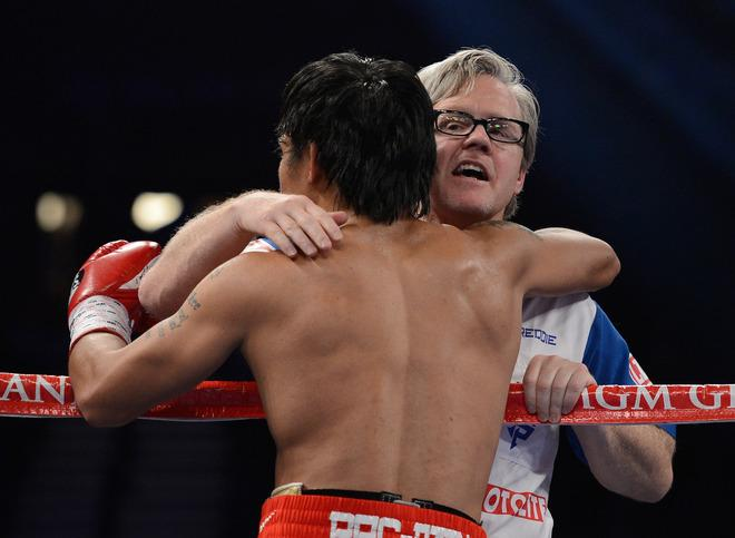 LAS VEGAS, NV - JUNE 09:  (R-L) Trainer Freddie Roach gives Manny Pacquiao a hug between rounds during his bout against Timothy Bradley at MGM Grand Garden Arena on June 9, 2012 in Las Vegas, Nevada.  (Photo by Kevork Djansezian/Getty Images)