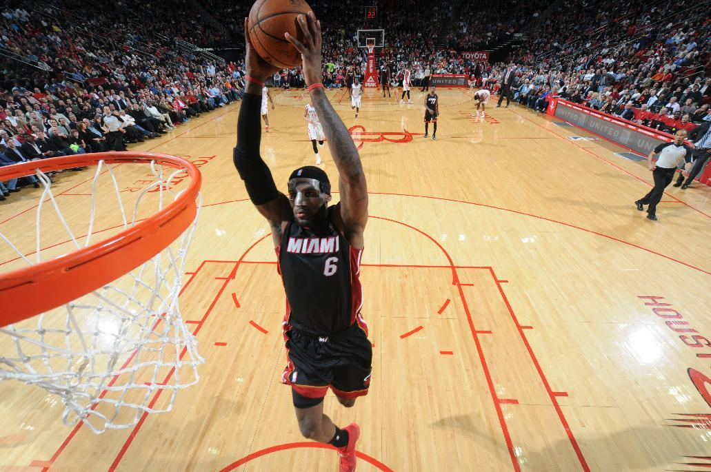 HOUSTON, TX - MARCH 4: LeBron James #6 of the Miami Heat dunks against the Houston Rockets on March 4, 2014 at the Toyota Center in Houston, Texas. (Photo by Bill Baptist/NBAE via Getty Images)