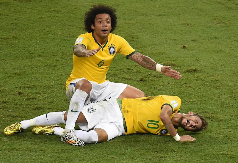 Defender Marcelo shouts for help after Brazil's forward Neymar was injured during the quarter-final football match between Brazil and Colombia at the Castelao Stadium in Fortaleza during the 2014 FIFA World Cup on July 4, 2014