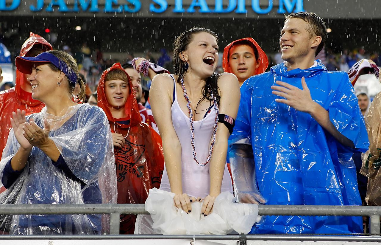 TAMPA, FL - JUNE 08:  Fans of Team USA cheer on their team in the rain against Team Antigua and Barbuda during the FIFA World Cup Qualifier Match at Raymond James Stadium on June 8, 2012 in Tampa, Florida.  (Photo by J. Meric/Getty Images)