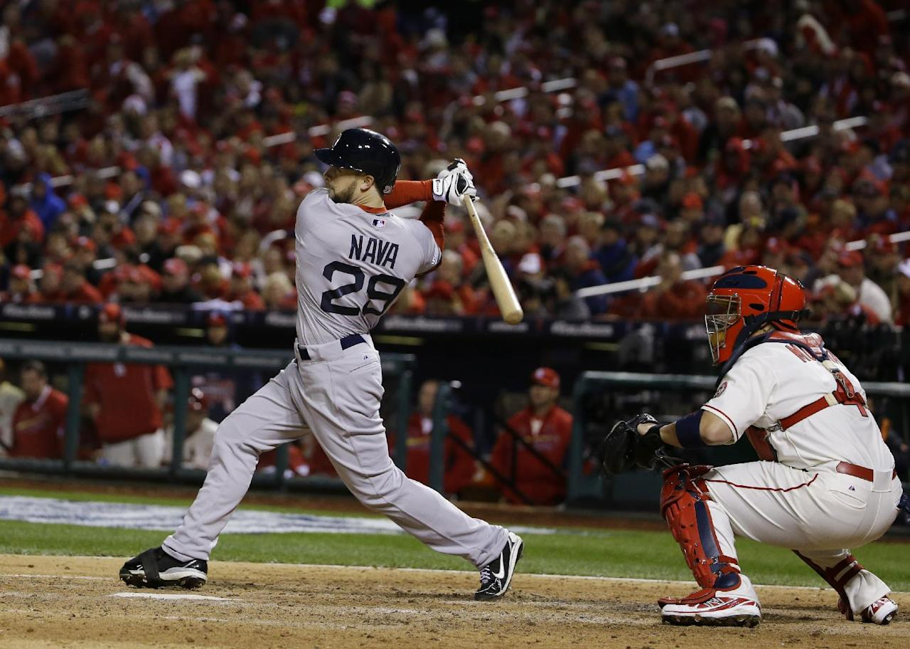 Boston Red Sox's Daniel Nava hits an RBI single during the sixth  inning of Game 3 of baseball's World Series against the St. Louis Cardinals Saturday, Oct. 26, 2013, in St. Louis. (AP Photo/Matt Slocum)