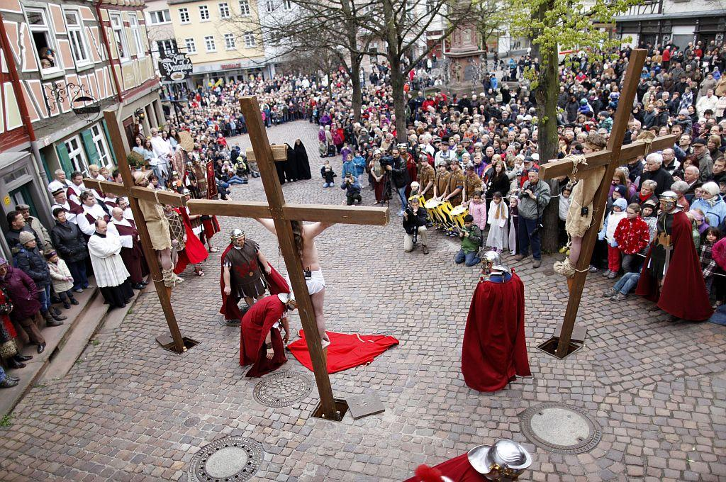 Actors take part in a re-enactment of the crucifixion of Jesus by the Romans on Good Friday 2012 in Bensheim, Germany. Christians all over the world take part in processions retracing the steps tradition says Jesus Christ took to his crucifixion.
