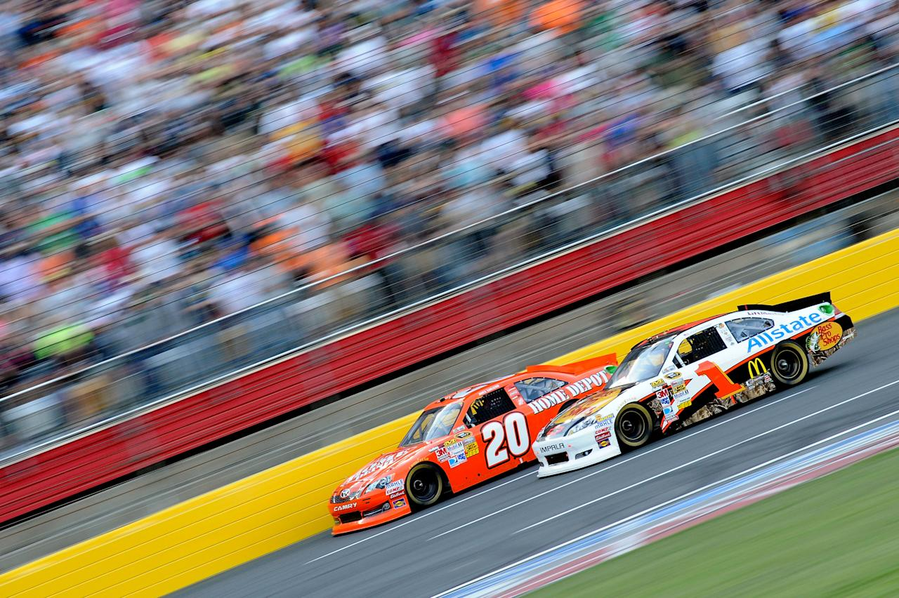 CHARLOTTE, NC - MAY 19:  Joey Logano, driver of the #20 The Home Depot Toyota, and Jamie McMurray, driver of the #1 Bass Pro Shops/Allstate Chevrolet, race during the NASCAR Sprint Showdown at Charlotte Motor Speedway on May 19, 2012 in Charlotte, North Carolina.  (Photo by Jared C. Tilton/Getty Images)