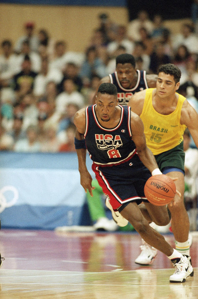 U.S. Olympic basketball team player Scottie Pippen is seen driving down the court Friday night, August 1, 1992 in Barcelona, Spain, as he is pursued by Brazil player Israel Machado during Olympic basketball action. The U.S. defeated Brazil 127-83. (AP Photo/Susan Ragan)
