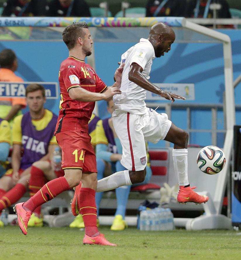 Belgium's Dries Mertens, left, pushes United States' DaMarcus Beasley to get him out of bounds during the World Cup round of 16 soccer match between Belgium and the USA at the Arena Fonte Nova in Salvador, Brazil, Tuesday, July 1, 2014. (AP Photo/Marcio Jose Sanchez)