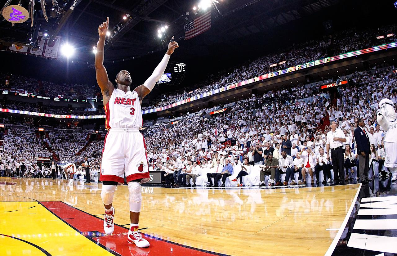 MIAMI, FL - MAY 22:  Dwyane Wade #3 of the Miami Heat greets the cowd during Game Five of the Eastern Conference Semifinals in the 2012 NBA Playoffs against the Indiana Pacers at AmericanAirlines Arena on May 22, 2012 in Miami, Florida. NOTE TO USER: User expressly acknowledges and agrees that, by downloading and/or using this Photograph, User is consenting to the terms and conditions of the Getty Images License Agreement.  (Photo by Mike Ehrmann/Getty Images)