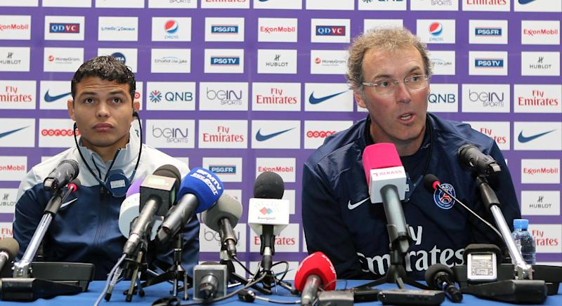 Laurent Blanc (right) and Thiago Silva give a press conference in Doha on January 1, 2014 ahead of a friendly game