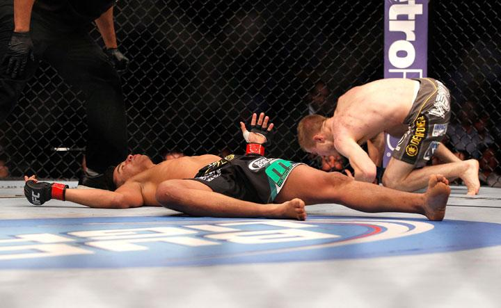 ATLANTA, GA - APRIL 21:  Miguel Angel Torres (L) lays on the matt after being knocked out by Michael McDonald (R) during their Bantamweight bout for UFC 145 at Philips Arena on April 21, 2012 in Atlanta, Georgia.