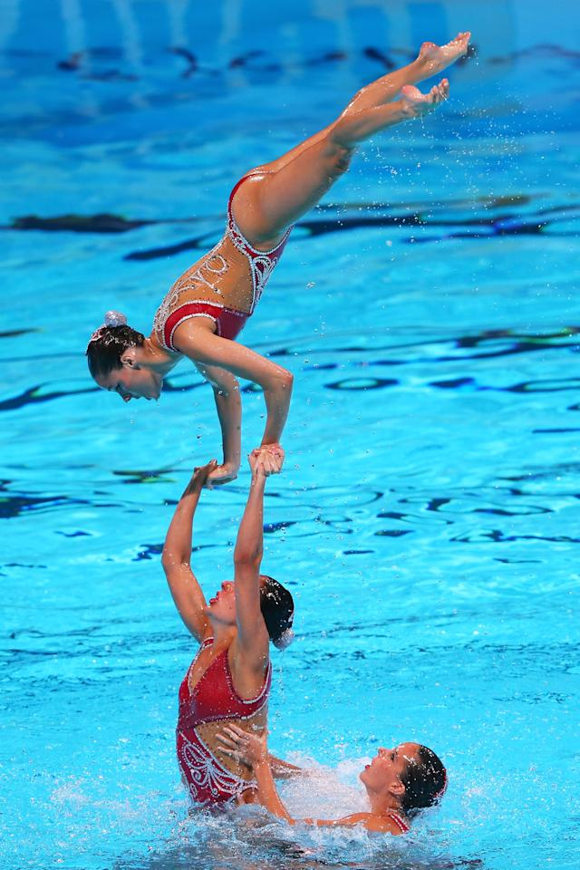 BARCELONA, SPAIN - JULY 23: Spain compete in the Synchronized Swimming Team preliminary round on day four of the 15th FINA World Championships at Palau Sant Jordi on July 23, 2013 in Barcelona, Spain. (Photo by Alexander Hassenstein/Getty Images)