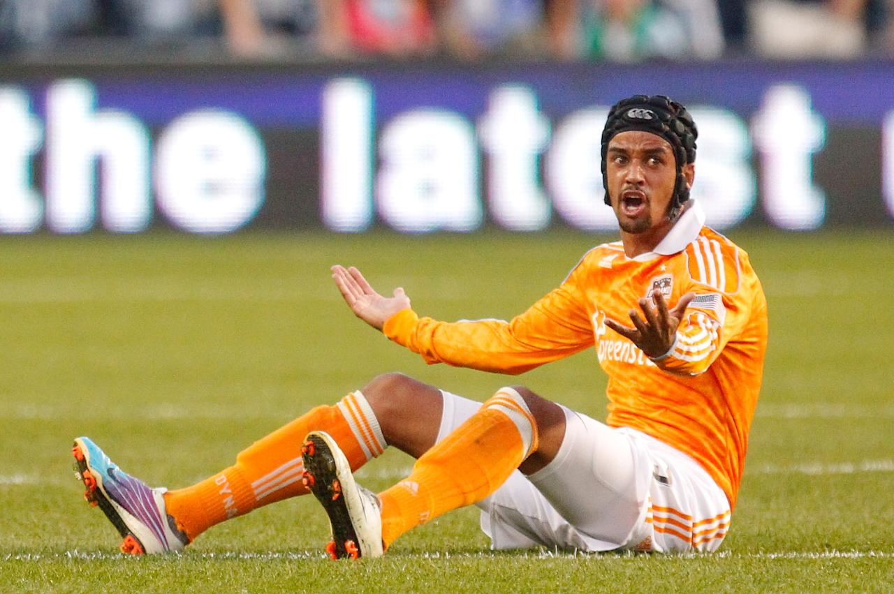 KANSAS CITY, KS - NOVEMBER 06: Calen Carr #03 of the Houston Dynamo looks towards the referee after being tripped by Sporting Kansas City in the first half during the MLS Eastern Conference Championship match at Livestrong Sporting Park on November 06, 2011 in Kansas City, Kansas.  (Photo by Kyle Rivas/Getty Images)