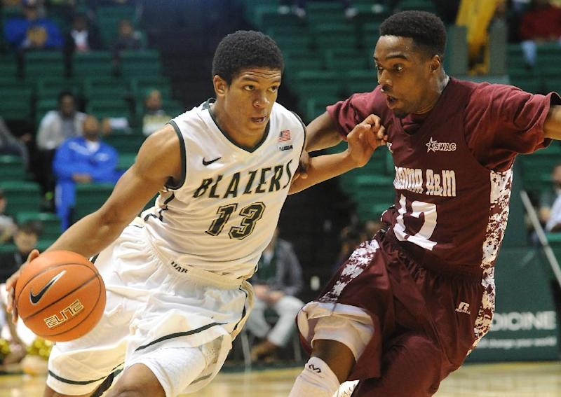 UAB's Chad Frazier, left, works against the pressure of Alabama A&M's Green Hill during the first half of an NCAA college basketball game in Birmingham, Ala., Sunday, Dec. 29, 2013. UAB won 69-57