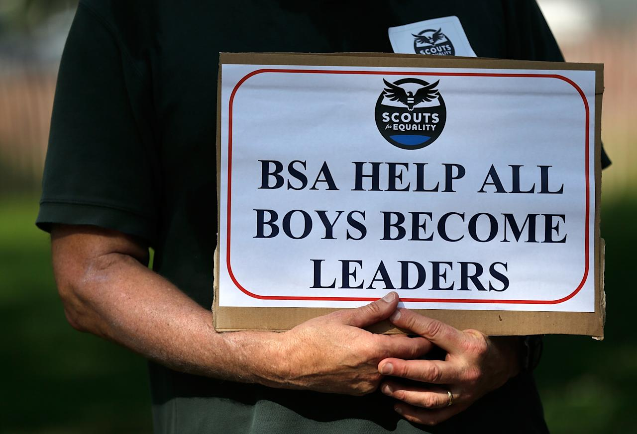 """WASHINGTON, DC - MAY 22:  Members of Scouts for Equality hold a rally to call for equality and inclusion for gays in the Boy Scouts of America as part of the """"Scouts for Equality Day of Action"""" May 22, 2013 in Washington, DC. The Boy Scouts of America is scheduled to hold a two day meeting tomorrow with 1,400 local adult leaders to consider changing its policy of barring openly gay teens from participating in the Boy Scouts.  (Photo by Win McNamee/Getty Images)"""