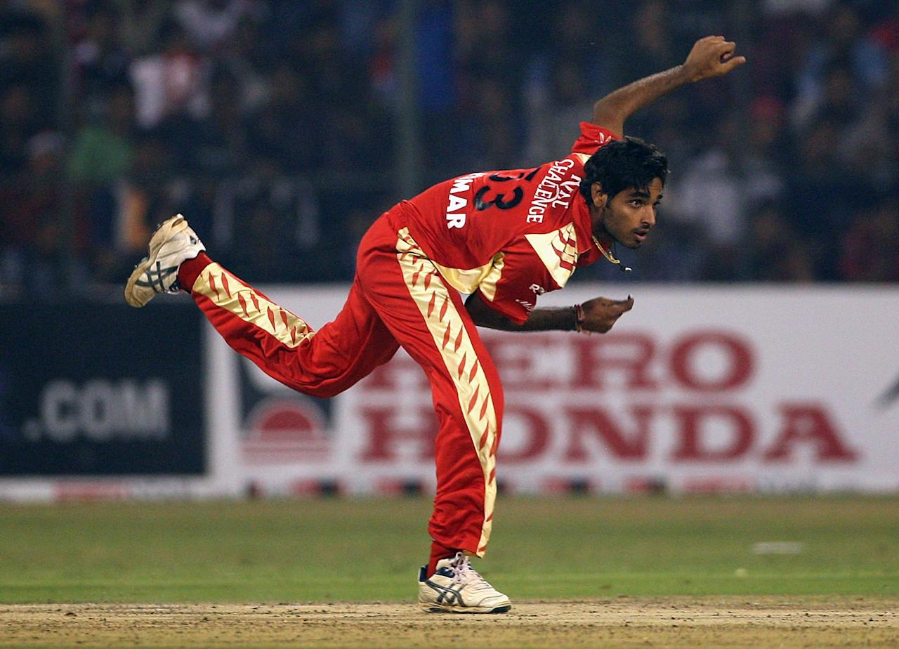 BANGALORE, INDIA - OCTOBER 17:  Bhuvneshwar Kumar of RC Bangalore bowls during the Airtel Champions League Twenty20 League Match between the Delhi Daredevils and RC Bangalore at M Chinnaswamy Stadium on October 17, 2009 in Bangalore, India.  (Photo by Cameron Spencer - GCV/GCV via Getty Images)