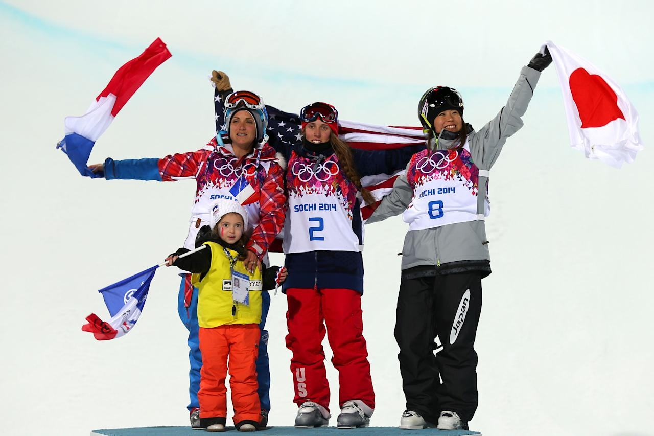 SOCHI, RUSSIA - FEBRUARY 20: Gold medalist Maddie Bowman (C) of the United States poses with silver medalist Marie Martinod (L) of France and her daughter Melirose and bronze medalist Ayana Onozuka of Japan during the flower ceremony after the Freestyle Skiing Ladies' Ski Halfpipe Finals on day thirteen of the 2014 Winter Olympics at Rosa Khutor Extreme Park on February 20, 2014 in Sochi, Russia. (Photo by Mike Ehrmann/Getty Images)