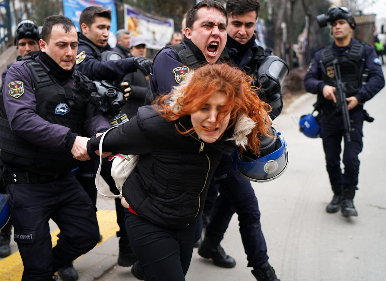 Riot police detain a demonstrator during a protest against the dismissal of academics from universities following a post-coup emergency decree, outside the Cebeci campus of Ankara University in Ankara, Turkey, February 10, 2017. REUTERS/Umit Bektas     TPX IMAGES OF THE DAY
