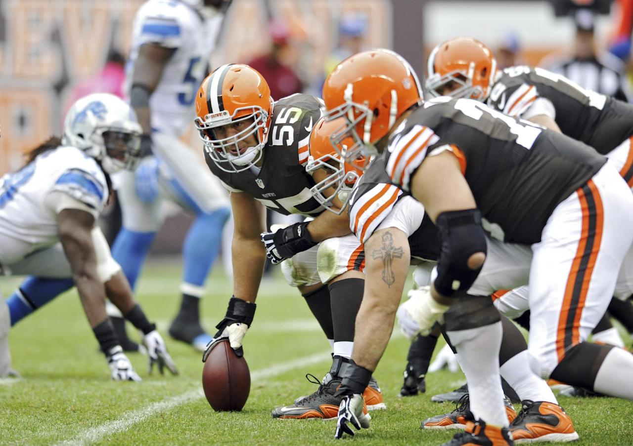 FILE - In this Oct. 13, 2013 file photo, Cleveland Browns center Alex Mack looks down the line in the fourth quarter of an NFL football game against the Detroit Lions in Cleveland. The steady center, who has not missed a snap since joining the Browns in 2009, is eligible for free agency and could walk away from the only NFL team he has known. (AP Photo/David Richard)
