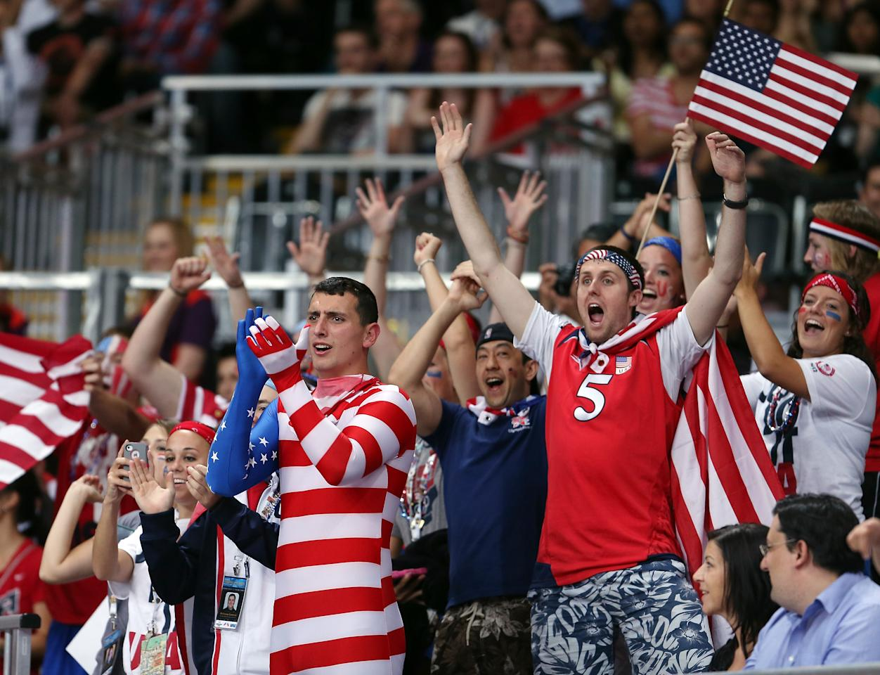 LONDON, ENGLAND - JULY 28:  United States fans cheer on their team as they take on Korea during Women's Volleyball on Day 1 of the London 2012 Olympic Games at Earls Court on July 28, 2012 in London, England.  (Photo by Elsa/Getty Images)