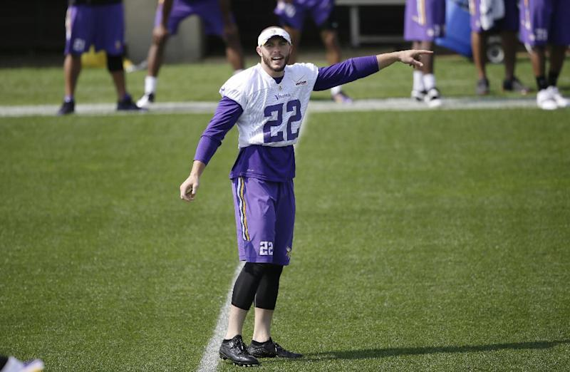 Smith learning from the best in Vikings secondary