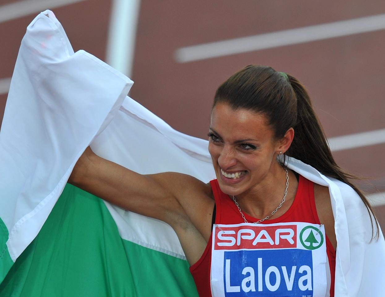 Bulgaria's Ivet Lalova celebrates after winning the women's 100m final at the 2012 European Athletics Championships at the Olympic Stadium in Helsinki on June 28, 2012. Bulgaria's Ivet Lalova won the race ahead of Ukraine's Olesya Povh and Lithuania's Lina Grincikaite.    AFP PHOTO / YURI KADOBNOVYURI KADOBNOV/AFP/GettyImages