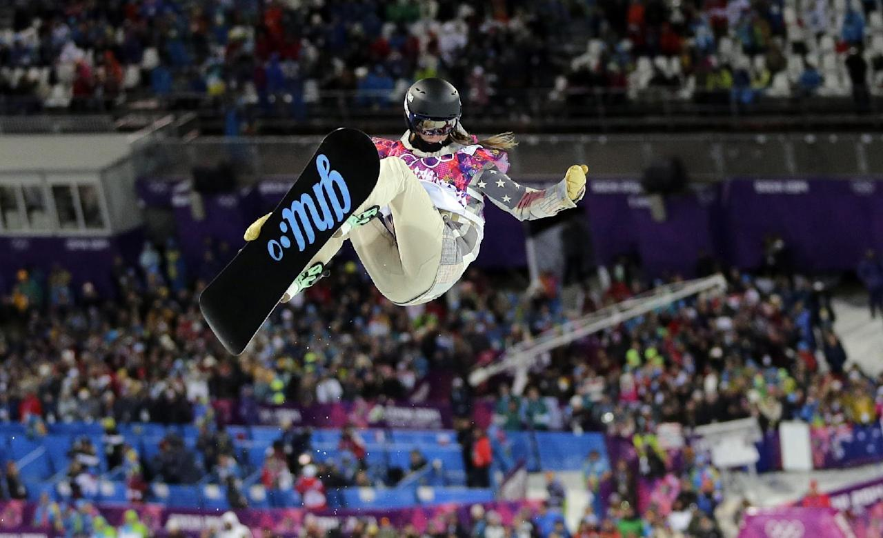 during the women's snowboard halfpipe semifinal at the Rosa Khutor Extreme Park, at the 2014 Winter Olympics, Wednesday, Feb. 12, 2014, in Krasnaya Polyana, Russia. (AP Photo/Andy Wong)