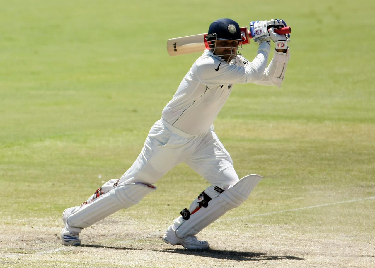 ADELAIDE, AUSTRALIA - JANUARY 28:  Virender Sehwag of India hits one to the boundary during day five of the Fourth Test between Australia and India at Adelaide Oval January 28, 2008 in Adelaide, Australia.  (Photo by Robert Cianflone/Getty Images)