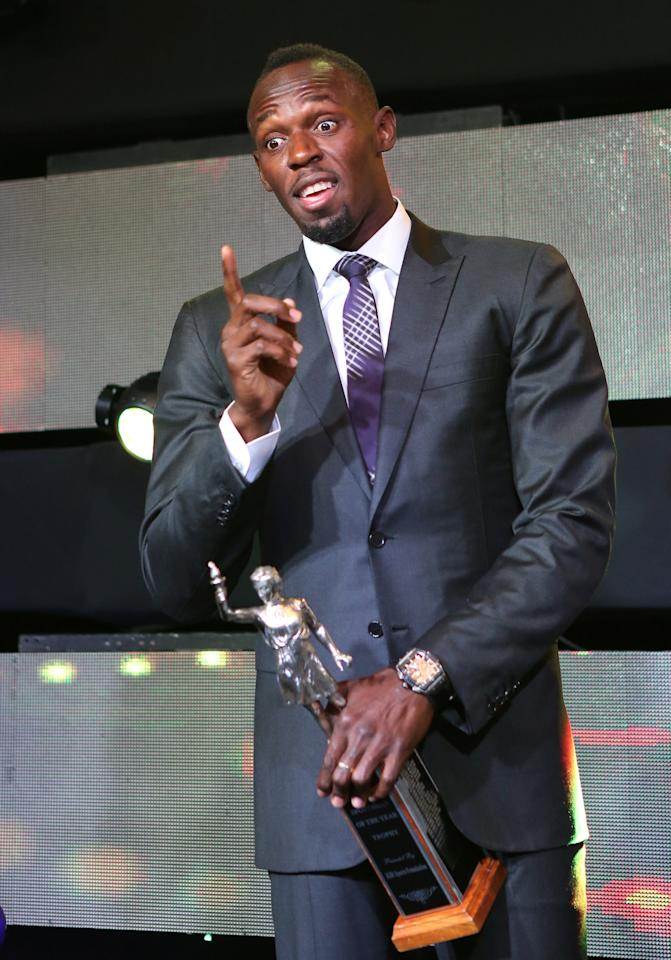 Jamaican sprinter Usain Bolt gestures after being presented with the Sportsman of the Year 2016 award during the National Sportsman and Sportswoman of the Year award ceremony in Kingston, Jamaica January 13, 2017. Picture taken January 13, 2017. REUTERS/Gilbert Bellamy