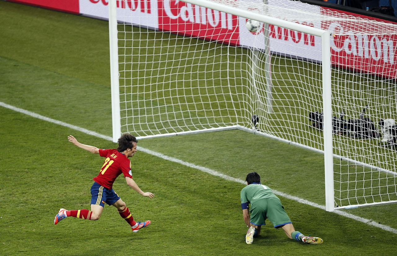 Spain's David Silva, left, scores the opening goal past Italy goalkeeper Gianluigi Buffon, right, during the Euro 2012 soccer championship final between Spain and Italy in Kiev, Ukraine, Sunday, July 1, 2012. (AP Photo/Darko Vojinovic)