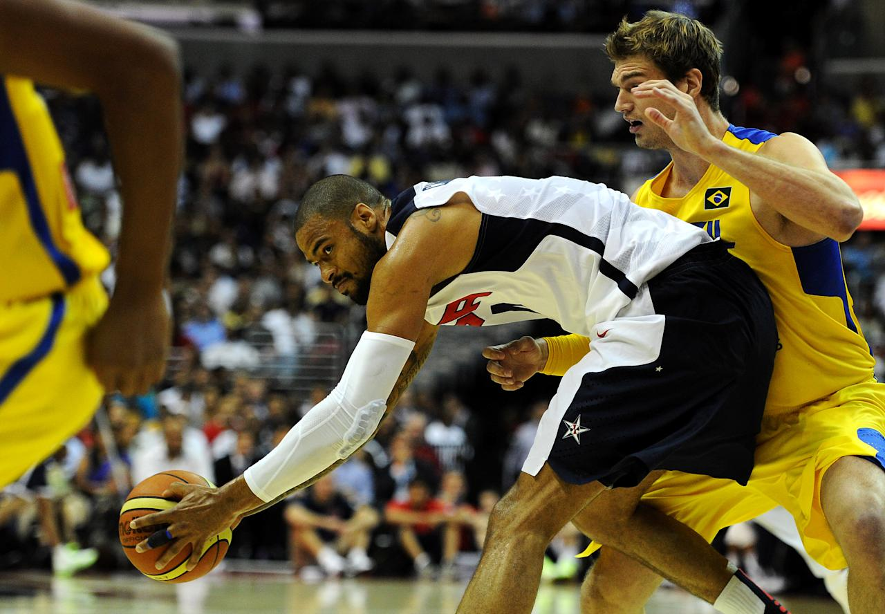 WASHINGTON, DC - JULY 16: Tyson Chandler #4 of the US Men's Senior National Team holds of Tiago Splitter #15 of Brazil from stealing the ball during the first quarter  during a pre-Olympic exhibition basketball game at the Verizon Center on July 16, 2012 in Washington, DC. (Photo by Patrick Smith/Getty Images)