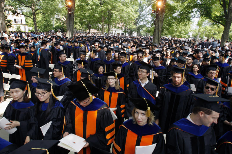 "Members of the class of 2011 are seen during commencement at Princeton University, Tuesday, May 31, 2011, in Princeton, N.J. The former home run record-holder Baseball Hall of Famer Hank Aaron was awarded an honorary doctorate of humanities for making America a better place with his ""imperishable example of grace under pressure."" (AP Photo/Mel Evans)"