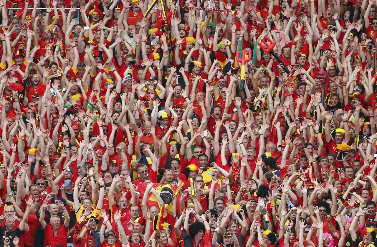 Belgian fans wave during their 2014 World Cup Group H soccer match against Russia at the Maracana stadium in Rio de Janeiro June 22, 2014. REUTERS/Yves Herman (BRAZIL - Tags: SOCCER SPORT WORLD CUP TPX IMAGES OF THE DAY)