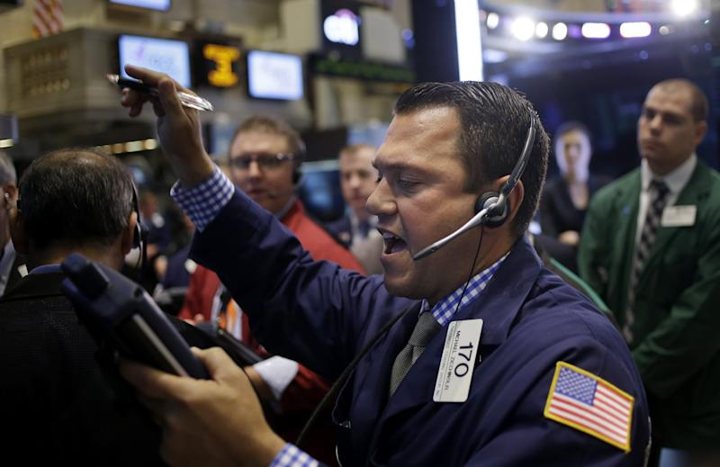 Stocks end slightly higher after rally fades