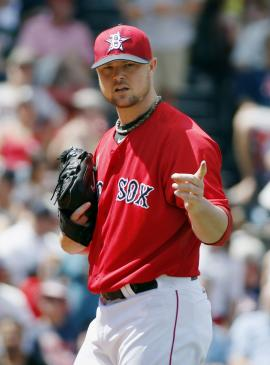 Jon Lester is expected to now become the ace of the A's staff. (AP)