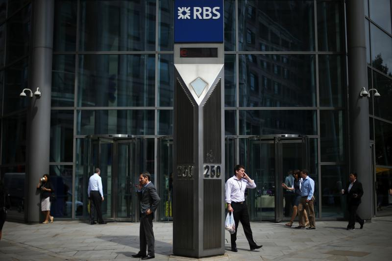 Men speak on their mobile phones outside a Royal Bank of Scotland office in the City of London
