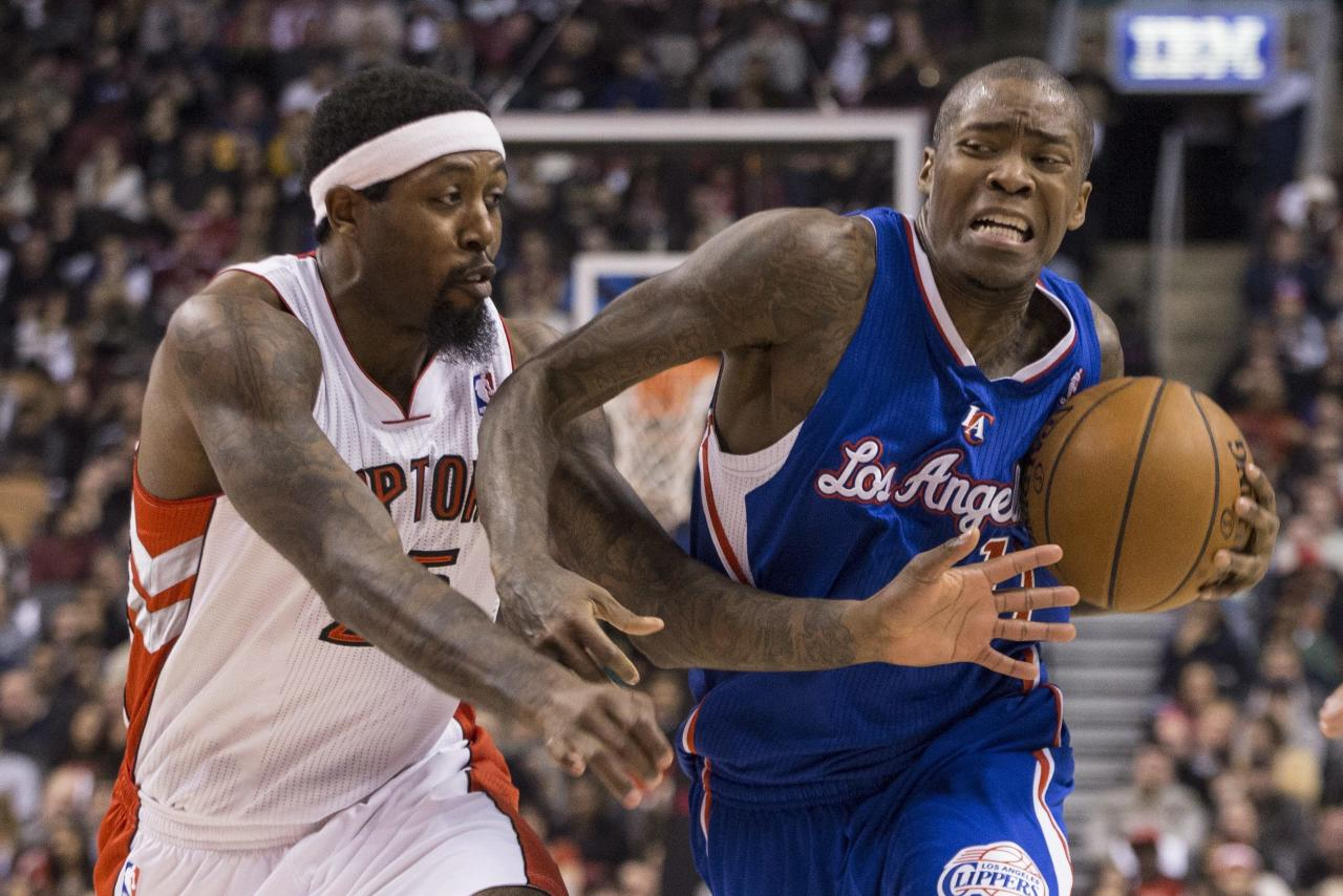Los Angeles Clippers' Jamal Crawford, right, drives past Toronto Raptors' John Salmons during the first half of an NBA basketball game, Saturday, Jan. 25, 2014 in Toronto. (AP Photo/The Canadian Press, Chris Young)