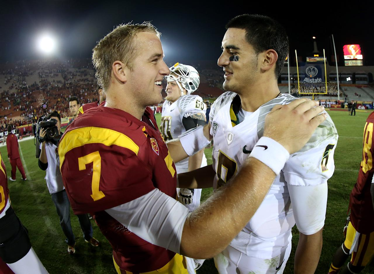 LOS ANGELES, CA - NOVEMBER 03: Quarterbacks Marcus Mariota #8 of the Oregon Ducks and Matt Barkley #7 of the USC Trojans meet after the game at the Los Angeles Memorial Coliseum on November 3, 2012  in Los Angeles, California.  Oregon won 62-51.  (Photo by Stephen Dunn/Getty Images)